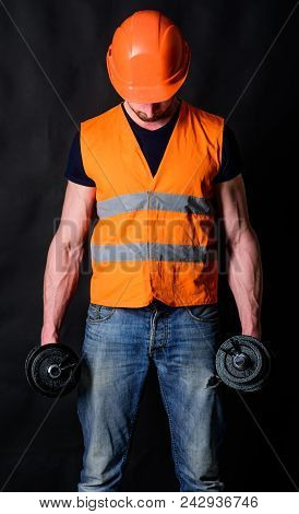 Worker, Contractor, Builder On Busy Face With Muscular Biceps. Strong Builder Concept. Builder In He