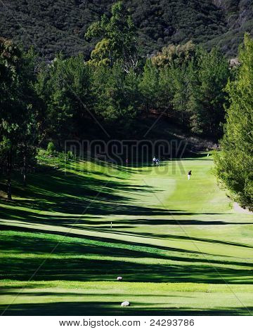 Golf fairway with Mountains in background