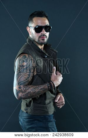 Tattooed Man With Biceps And Triceps. Tattoo Model With Beard On Unshaven Face. Bearded Man With Tat