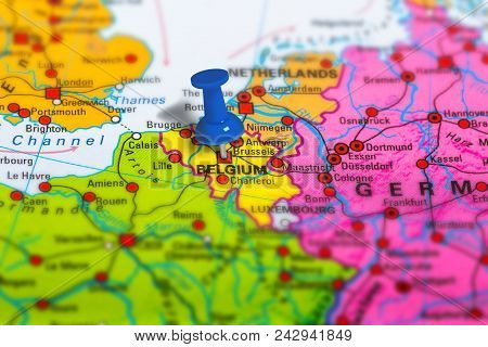 Brussels In Belgium Pinned On Colorful Political Map Of Europe. Geopolitical School Atlas. Tilt Shif
