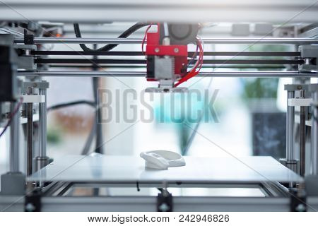 Brand New Model. The Close Up Of A State-of-the-art 3d Printer Creating A New 3d Model While Standin