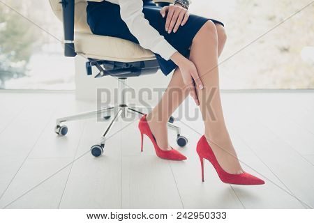 Cropped Portrait Bottom View Of Woman's Legs Wearing Black Skirt Red High Heel Shoes Sitting On Armc