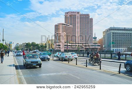 Cairo, Egypt - December 24, 2017: The Busy Road On Qasr El Nil Bridge With Modern Tourist Hotels Of