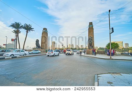 Cairo, Egypt - December 24, 2017: The Busy El Tahrir Road, Decorated With Stone Towers And Sculprtur