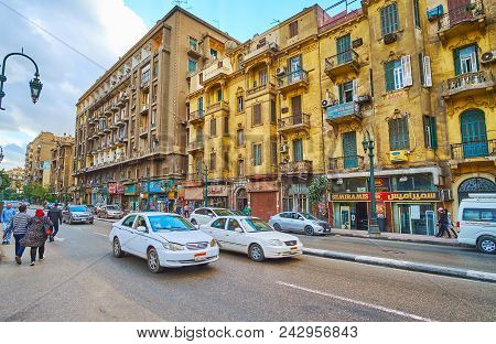 Cairo, Egypt - December 24, 2017:  The Traffic In Qasr Al Nil Street With A View On The Old Shabby B