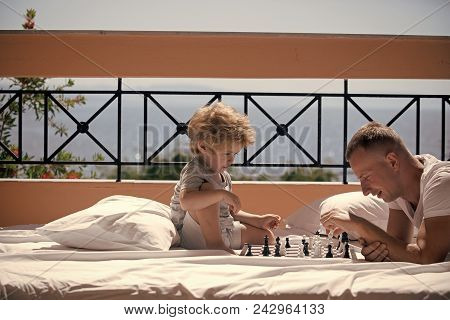 Kids Playing With Toys. Parent Play Chess With Kid On Terrace On Sunny Day. Father And Little Son Pl