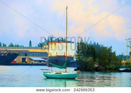 May 16, 2018 In Hilo, Hi:  Industrial Port And A Sail Boat Anchored In Hilo Hi Where People Can Anch