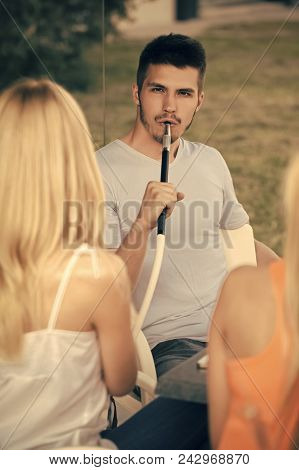 Handsome Man Face. Man Vapor Hookah Pipe With Girls In Shisha Bar Lounge. Celebration, Party Concept