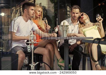 Woman Face Beauty. Twins Women And Men Relax In Shisha Cafe Outdoor. Celebration, Party Concept. Fri