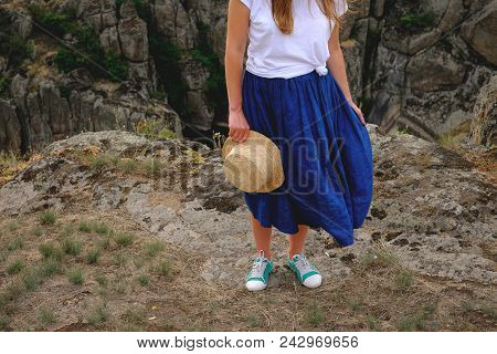 Happy Young Girl Standing On A Background Of The Canyon