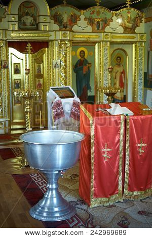 Holy Bible, Orthodox Cross And Bowl Prepared For Christening Ceremony In Church