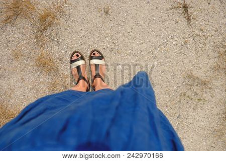 Photo Of Female Legs In Gumshoes On The Background Of The Canyon