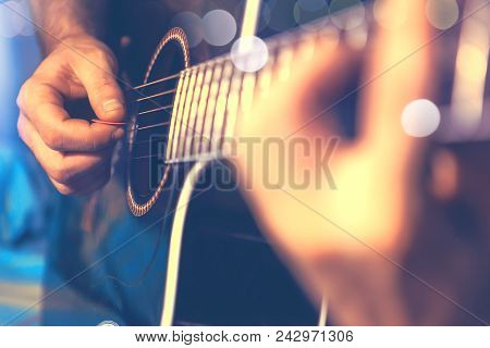 Acoustic Guitar And Guitarist Detail.live Music And Musical Instrument