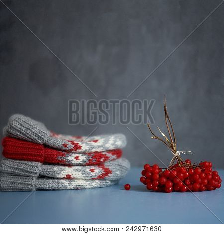 Four Knitted Winter Hats With Red Berries, Selective Focus, Vintage