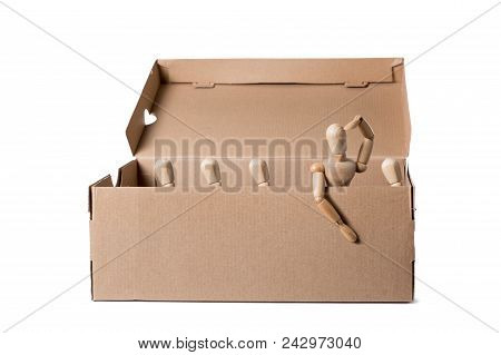 Brown Cardboard Box With Wooden Mannikins. One Of Them Is Looking Out Of It While Others Are Sitting