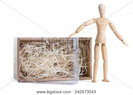 Wooden Mannikin Standing Near Open Cardboard Box Filled With Wood Shred. Concept Of Thinking Outside