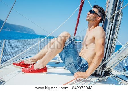 Young Man Relaxing On Sailing Yacht. Vacation, Sail Holidays, People Travel