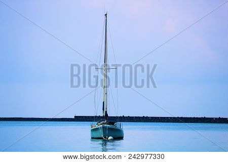 May 18, 2018 In Hilo, Hi:  Anchored Sail Boat In The Calm Waters At The Hilo, Hi Harbor Marina Where