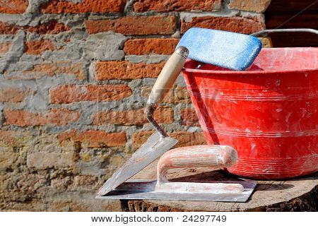 trowel spatula and bucket bricklayer tools