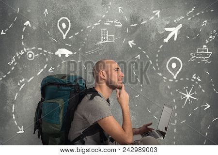 Explorer Man Plans A New Travel With His Laptop