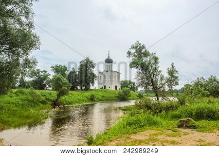 Sunny Spring Landscape. White Church On The River, In The Countryside. Nature