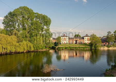 View Of River Severn From English Bridge In Shrewsbury Shropshire With Retirement Apartments In Back