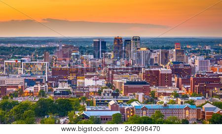 Birmingham, Alabama, USA downtown skyline from above at dusk.