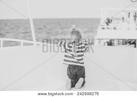 Child Childhood Children Happiness Concept. Small Cute Child Sitting Back On White Yacht. Childhood