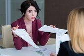 boss reproaching her employee. business woman getting a reprimand from chief manager. superior and subordinate professional relationship. poster