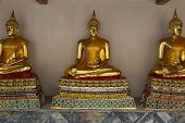 Wat Pho . Temple of the Reclining Buddha. Gilded Buddha statues. Bangkok. Thailand. Famous tourist destination, tourist attraction. poster