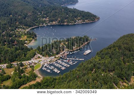 Snug Cove, Bowen Island, British Columbia, Canada. Aerial View Of A Marina And Ferry Terminal On The