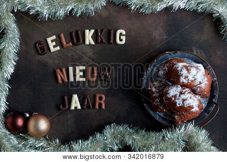 The Happy New Year Wish In Dutch With The National Delicacy Called Oliebollen Or Dougnut Balls.