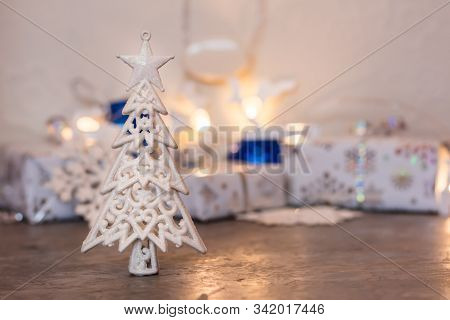 Christmas Still Life. Decoration Fir Tree With Sparkles On The Background Of Wrapped Gifts And Chris