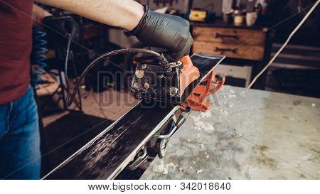 Applying Hot Wax To Ski Base With Iron. Applying Ski Wax To Ski Base. Ski Base Tuning. Ski Wax Iron
