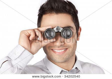Happy young businessman looking through binocular isolated on white background.