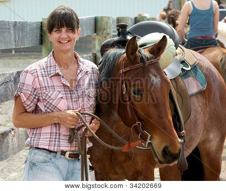Happy woman with horse