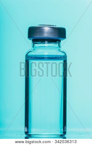 Glass Medical Ampoule Vial For Injection. Medicine Is Liquid Sodium Chloride With Of Aqueous Solutio