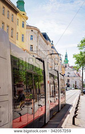 Typical Red Tram On Road In Wiedner Hauptstrasse Of Vienna