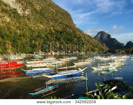 Coron, Philippines - Apr 8, 2017. Wooden Boats On The Sea In Coron Island, Philippines. Coron Is One