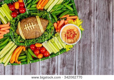 Football Meatloaf With Fresh Vegetable Platter And Dipping For Super Bowl Fan Party.
