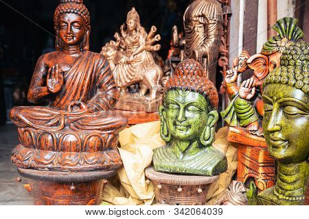 Religous Buddah Statues For Sale At A Home Decor Market In New Delhi India