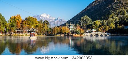 Beautiful Of Black Dragon Pool With Jade Dragon Snow Mountain Background, Landmark And Popular Spot