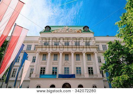Main Building Of Tu Wien With Flags In Vienna Austria