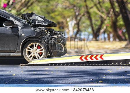 Accident Car Slide On Truck For Move. Black Car Have Damage By Accident On Road Take With Slide Truc