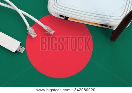 Bangladesh Flag Depicted On Table With Internet Rj45 Cable, Wireless Usb Wifi Adapter And Router. In