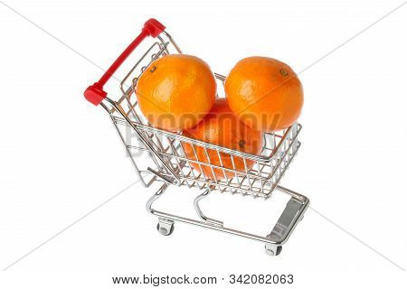 A Small Shoppimng Cart Filled With Clementines Isolated On White Background.