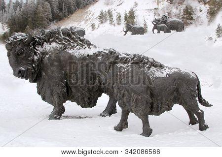 Khanty - Mansiysk, Russia - December 29, 2019: Sculptures Of A Prehistoric Bulls In Archeopark. Loca