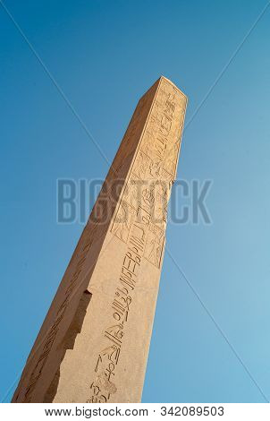 Obelisk Of Queen Hatshepsut In Karnak Temple, A Granite Needle Monolith In Luxor, Egypt, Isolated On