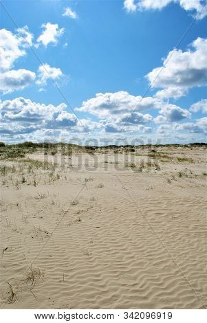 Romo Peninsula - Fantastic beach in denmark with colorful wind chimes. Cloudy summer day poster