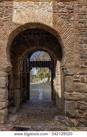 Old Gate In The Medieval Walls Of Toledo. Spain.